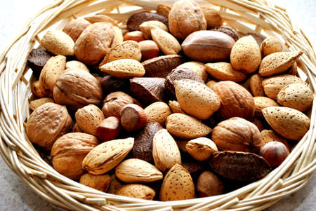 whole pecans: Basket Full of Mixed Nuts Stock Photo