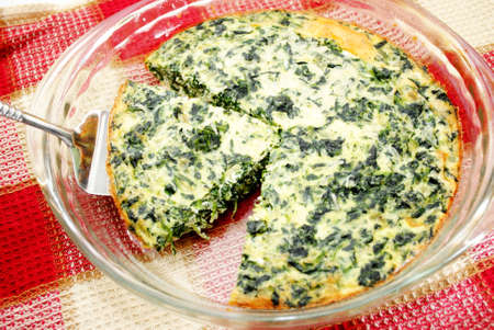 Serving Egg Quiche with Spinach and Cheese
