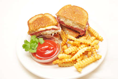 browned: Ruben Sandwiches Served with French Fries