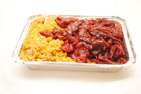 takeout: Chinese (American) Boneless Ribs with Pork Fried Rice in a Takeout Container Stock Photo