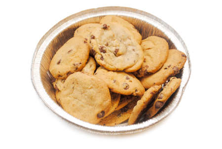 high calorie: Chocolate Chip Cookies in a Foil Tin Stock Photo