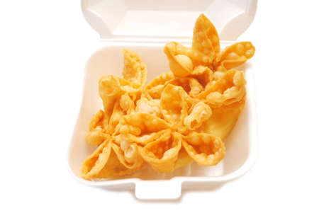 takeout: Deep Fried Crab Rangoon Appetizers Served in a Takeout Container Stock Photo