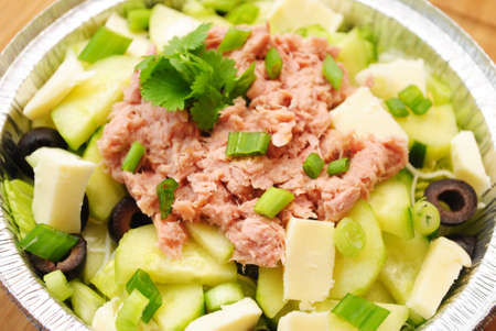 flaked: Fresh Vegetable Salad with Flaked Tuna on Top Stock Photo