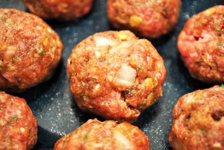Many Raw Meatballs Ready to be Baked Stock Photo