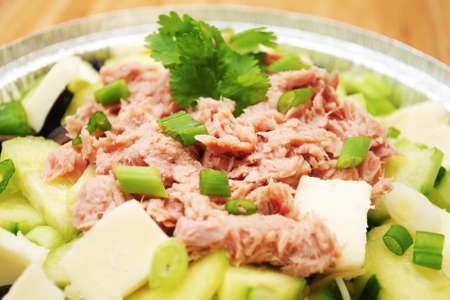flaked: Close-Up of Flaked Tuna on a Green Vegetable Salad