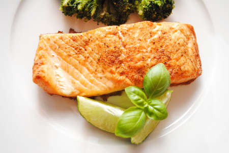 fishy: Gourmet Baked Salmon Served with Fresh Basil and Lime Wedges