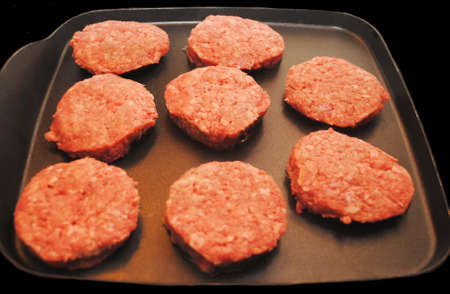 cook griddle: Slider Hamburgers Cooking on a Griddle