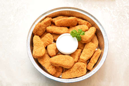 tenders: Chicken Nuggets with Ranch Dipping Sauce and Garnished with Parsley