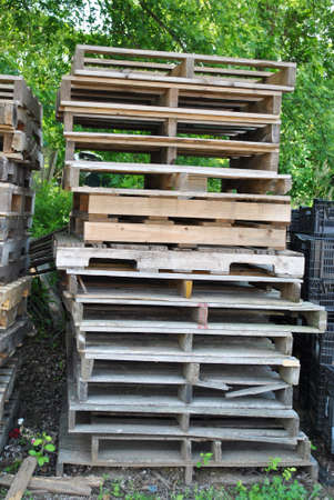 Stacked Wooden Pallets Discarded or Ready to be Used to Ship Products