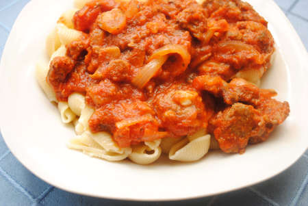 Pasta Shells Served with Chunky Meat Sauce Фото со стока