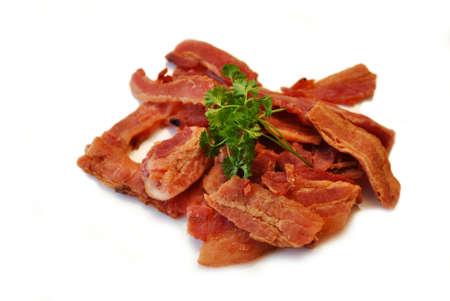 carnes: Bacon secado Jerky con perejil fresco Foto de archivo