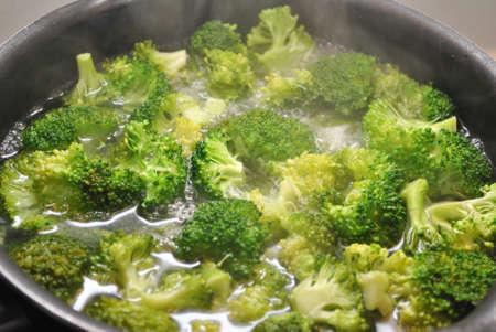 Boiling Broccoli in a Black Pan Archivio Fotografico