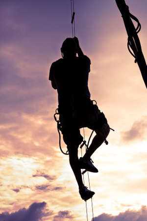 harness: Silhouette Of A Man Climbing To The Top