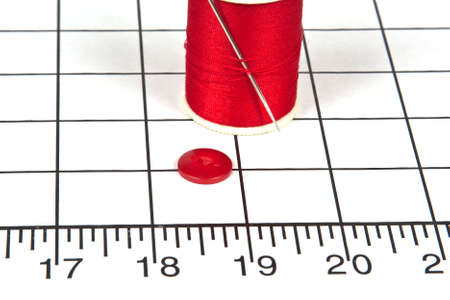 Sewing Needle with Spool of Thread and Button Stock Photo