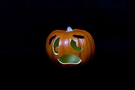 Halloween jack-o-lantern pumpkin on a black background.