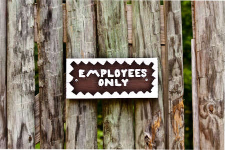 Sign with employees only written on it.