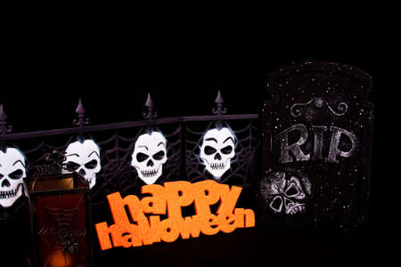 Halloween sign with skulls on a fence and a gravestone. Stock Photo - 7948933