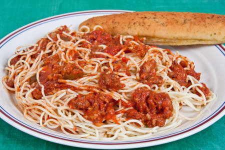 Spaghetti Dinner with breadstick on a plate