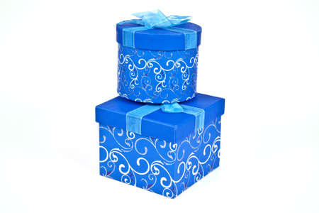 Christmas gift boxes wrapped in blue paper and ribbon