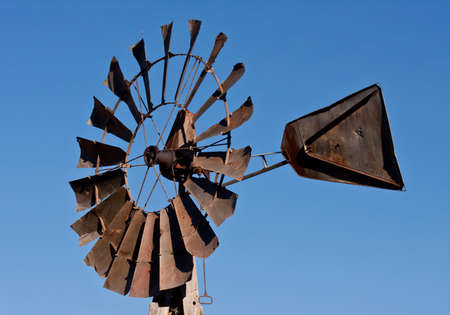 Metal windmill with a  blue sky background