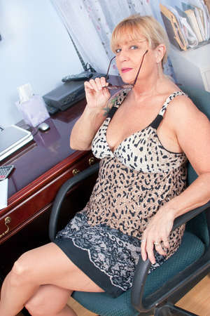 Woman Working in her home office with glasses