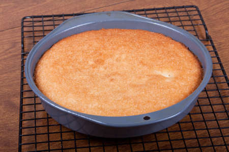 A baked cake just cooling before frosting and decorating Stock Photo