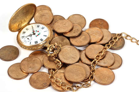 Pocket watch with old coins on a white background photo