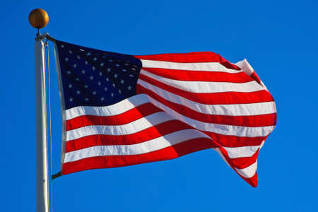 American flag flying in a beautiful, clear day photo