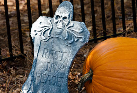 large pumpkin: Large pumpkin next to gravestone in the graveyard Stock Photo