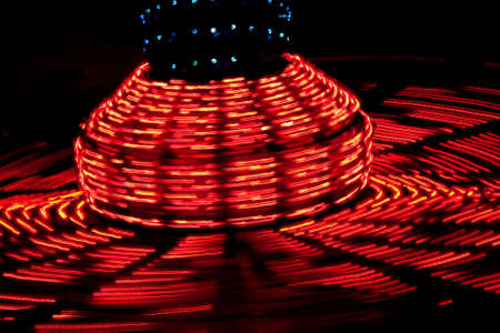 Carnival ride spinning with lights at night Stock Photo