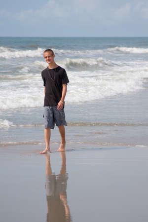 Young man enjoying a walk on the beach