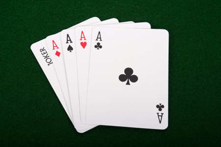 Four aces and a joker poker hand Stock Photo - 11027157