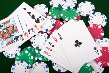 Poker hands laying on top of poker chips Stock Photo - 11027159
