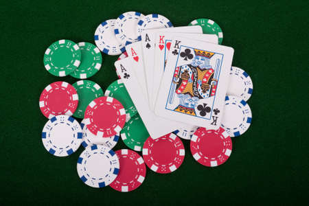 Aces and kings full house on poker chips