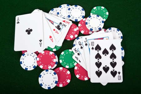 Poker hands laying on top of poker chips
