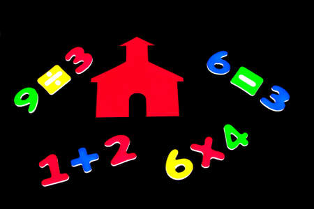 subtraction: Little red school house with addition, subtraction, multiplication and division on black background