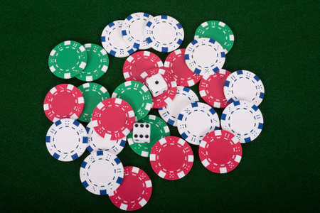 Pair of dice on a pile of poker chips