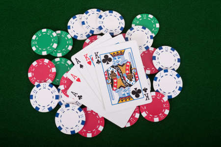 Aces and kings full house on poker chips Stock Photo - 10966699