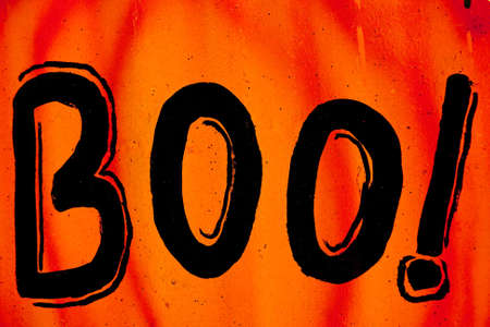 Orange Halloween sign with the word boo on it