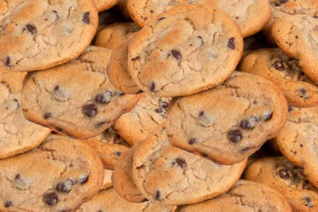 Many chocolate chip cookies fresh and ready to eat Stock Photo