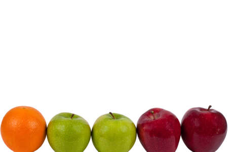 One orange, two green apples and two red apples on a white background Stock Photo - 11971686