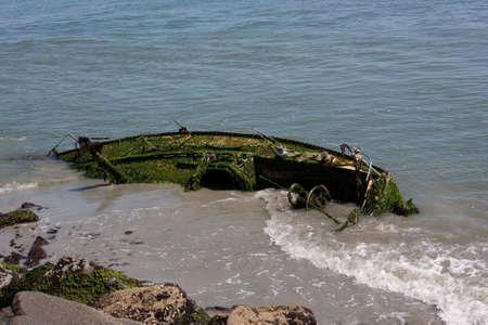 ship wreck: Sunken sailboat washed ashore