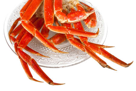 Crablegs cooked and placed on a fancy clear plate on a white background Stock Photo
