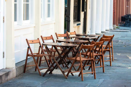 Outdoor restaurant sidewalk cafe simple wooden seating area