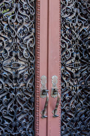 Ornate wrought iron imbedded double entry doors
