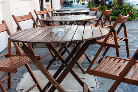 seating area: Outdoor restaurant sidewalk cafe simple wooden seating area