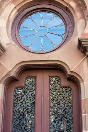 Beautiful architecture featuring ornate doors and window Stock Photo