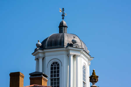 Old architecture showing the top of a building and weathervane