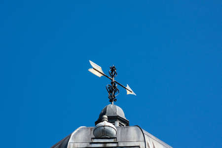 Weathervane on top of a old antique building
