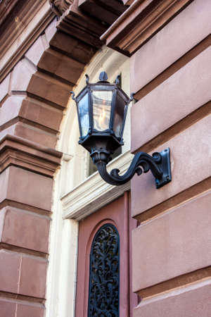 outdoor lighting: Ornate outdoor lighting on an old building
